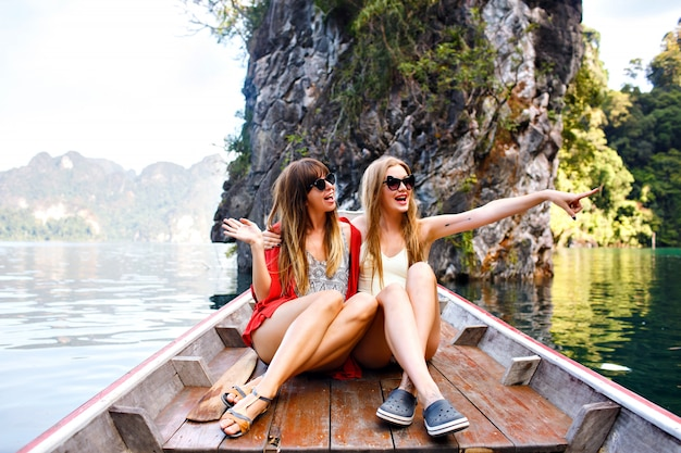 Two happy friends spending vacation in thailand khao sok mountains and lake