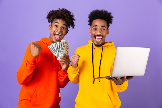 Two happy male friends in colorful hoodies Premium Photo