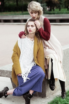 Two happy pretty young women, fashion shooting