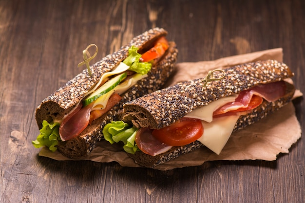 Two healthy sandwiches with ham, cheese and vegetables