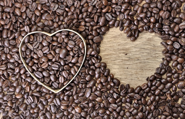 Two heart-shaped in coffee beans