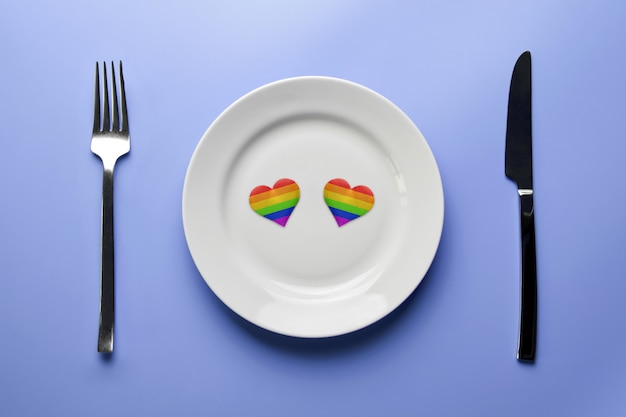 Two hearts in lgbt flag colors in plate