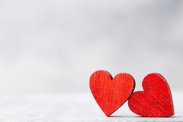 Two hearts. valentines day greeting card with bokeh background.
