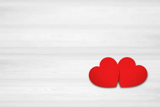 Two hearts on white wood background. valentines day concept.