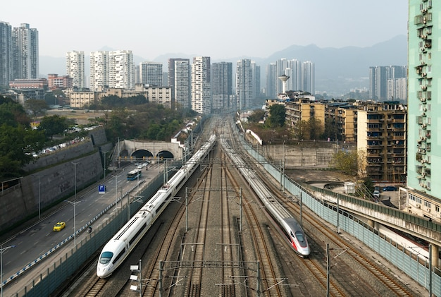 Two high-speed trains are running on the railway