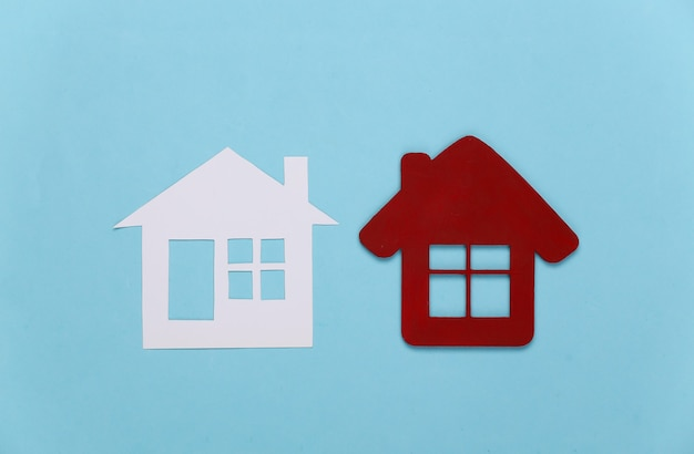Two house figure on blue.