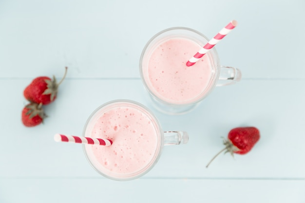 Two ice cream pink cocktails with strawberries
