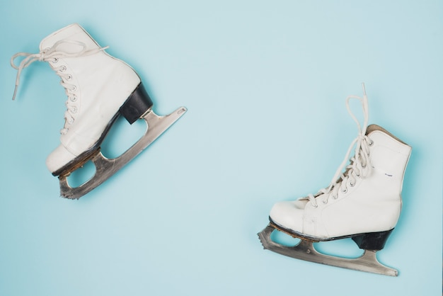 Two ice skates on blue