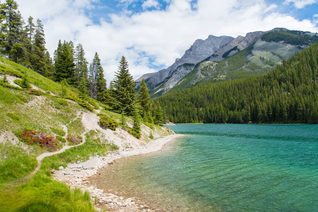 Two jack lake in banff national park, canada in sunny and cloudy day