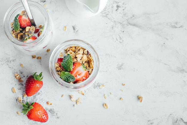 Two jars with tasty parfaits made of granola