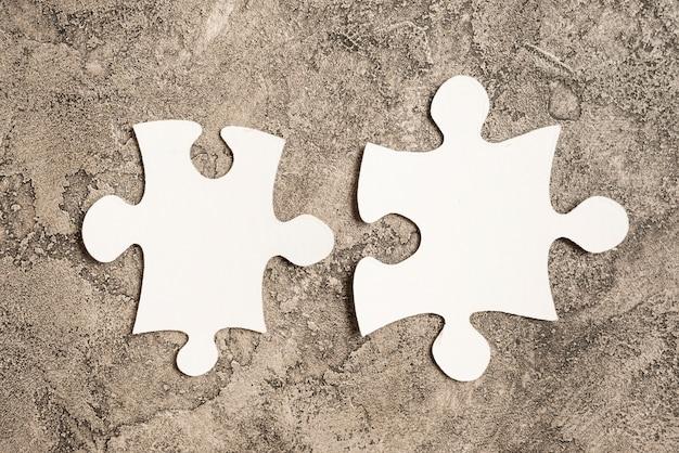Two jigsaw pieces