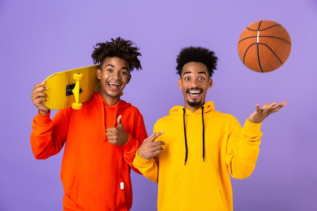 Two joyful best friends dressed in colorful hoodies