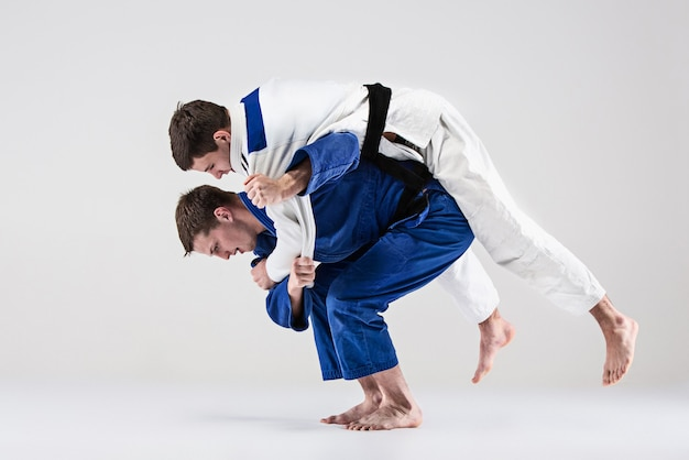 The two judokas fighters fighting men
