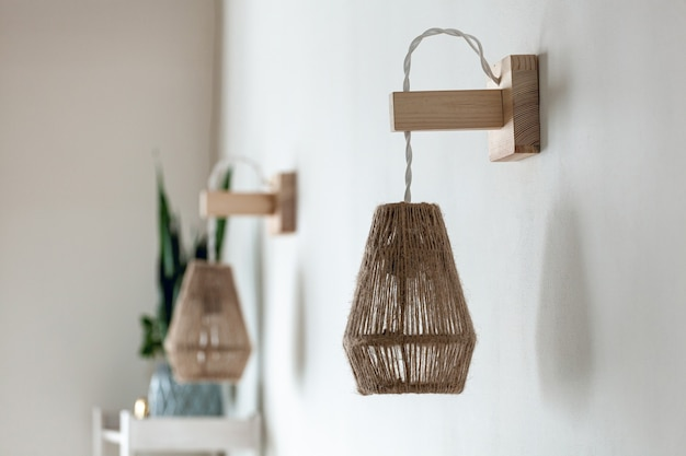 Two jute rope light lamps fixture with wooden wall mount