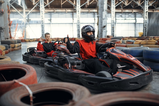 Two kart racers, karting auto sport indoor.