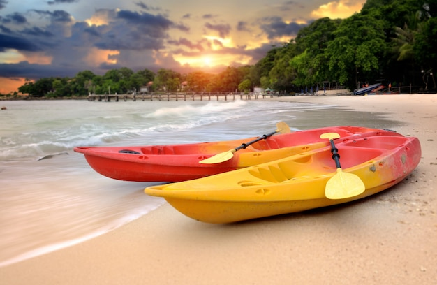 Two kayaks on the beach of the island