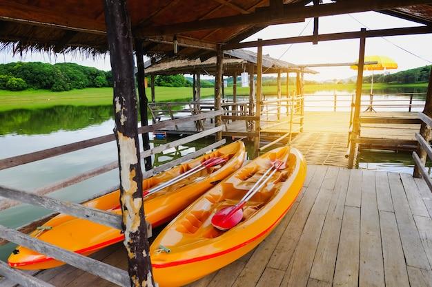 Two kayaks park at river