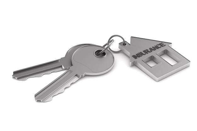 白いスペースに2つの鍵と小物の家