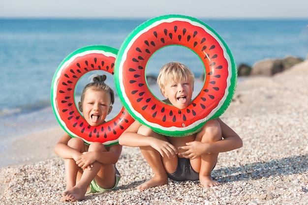 Two kids having fun on the beach