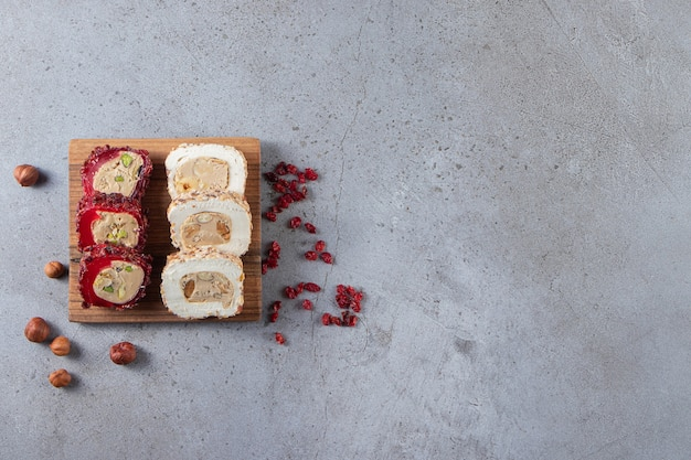 Two kinds of sliced delights with saffron on stone background.