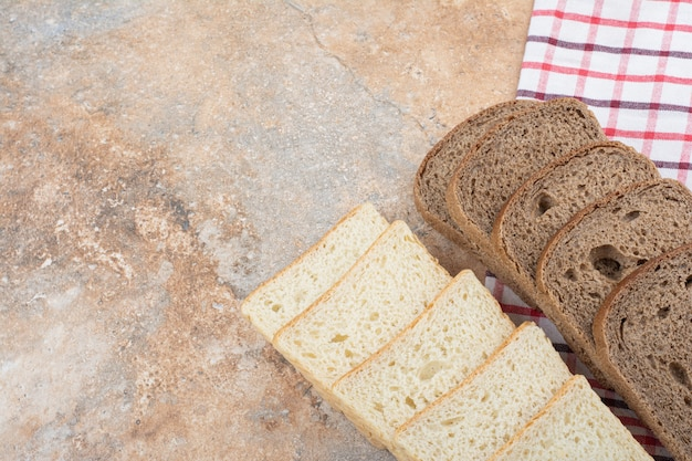 Two kinds of toast bread on tablecloth