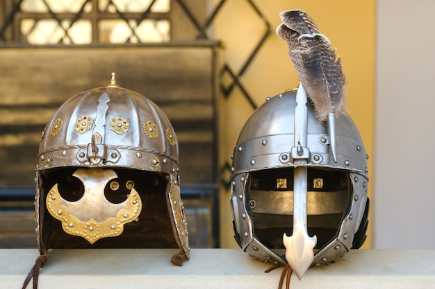Two knight's helmets are lying on the surface.medieval concept.