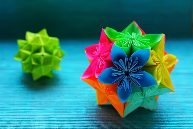 Two kusudama origami on blue background