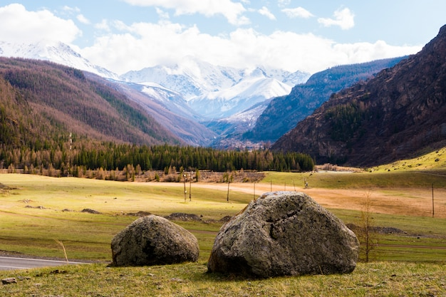 Two large stones in the middle of the altai mountain valley. altai mountains landscape
