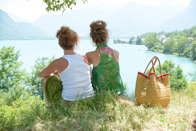 Two lesbians in nature admire the landscape