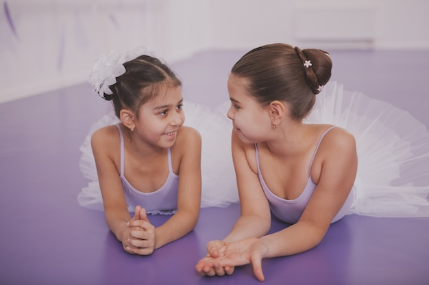 Two little ballerinas talking after dancing lesson