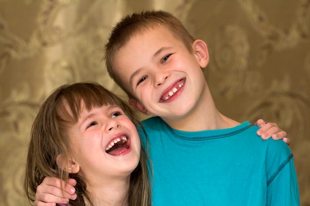 Two little children brother and sister together. girl hugging boy. family relations concept.