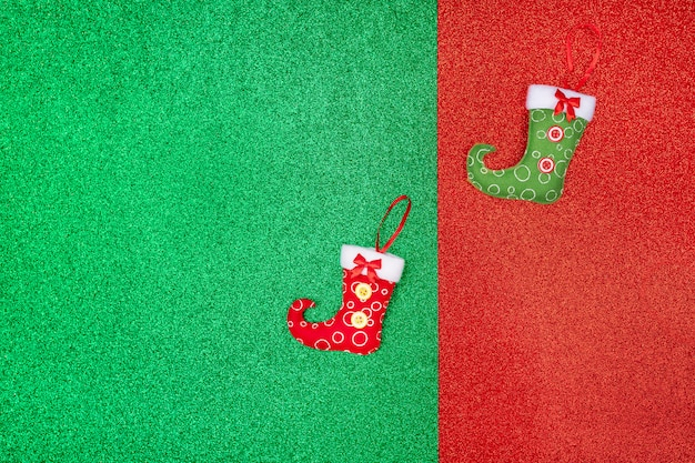 Two little christmas symbols located on a red-green shiny . santa year of the rat. . holiday. gift orders. new year's accessories.