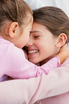 Two little smiley sisters playing at home together Premium Photo