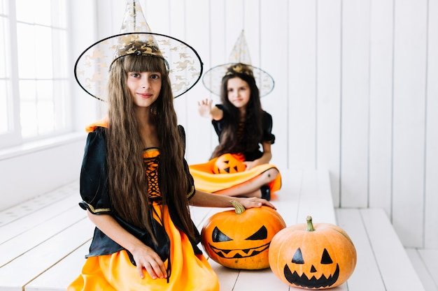 Two little witch at halloween party Free Photo