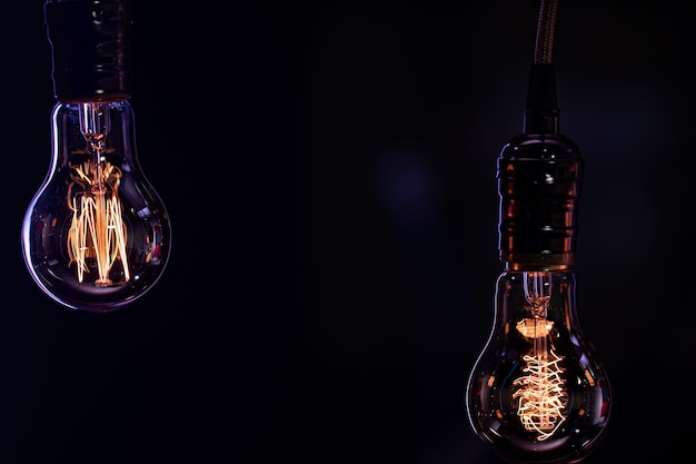 Two luminous lamps hang in the dark. decor and atmosphere concept.