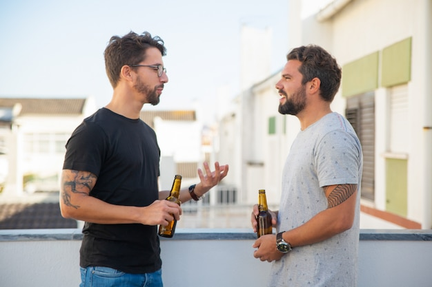 Two male friends excited with discussion