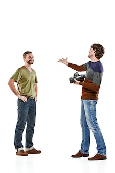 The two male friends with camera on white