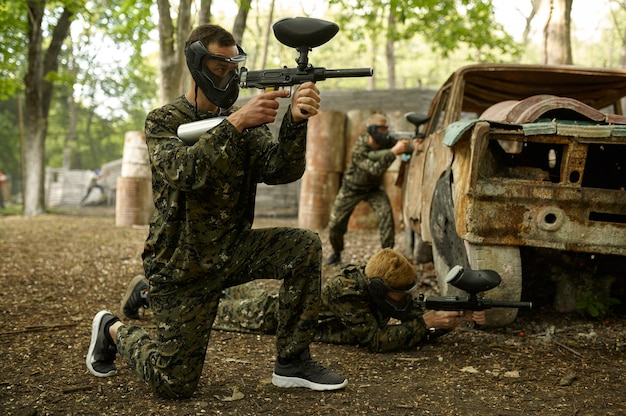 Two male warriors aimimg with paintball guns