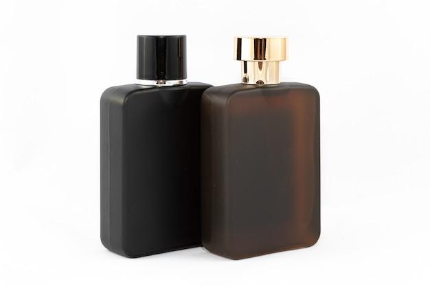 Two matte bottles of perfume for men on white background