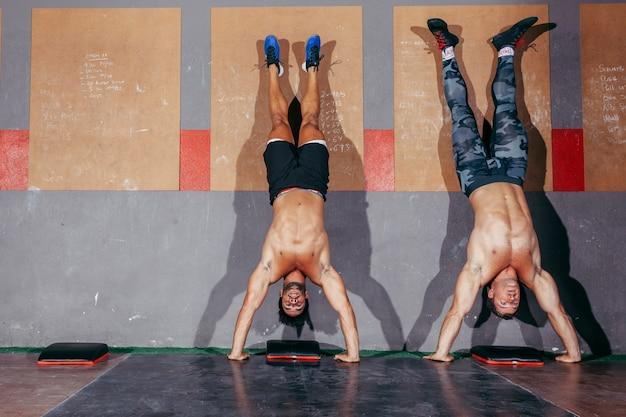Two men doing handstands