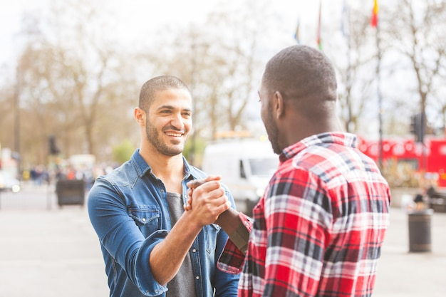 Two men giving a friendly handshake