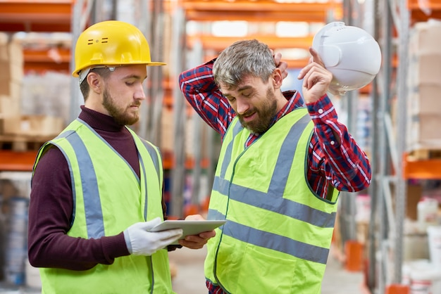 Two men working in warehouse