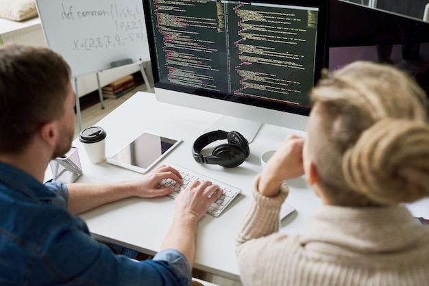 Two men writing code