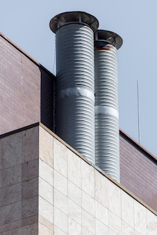 Two metal air duct on a building roof