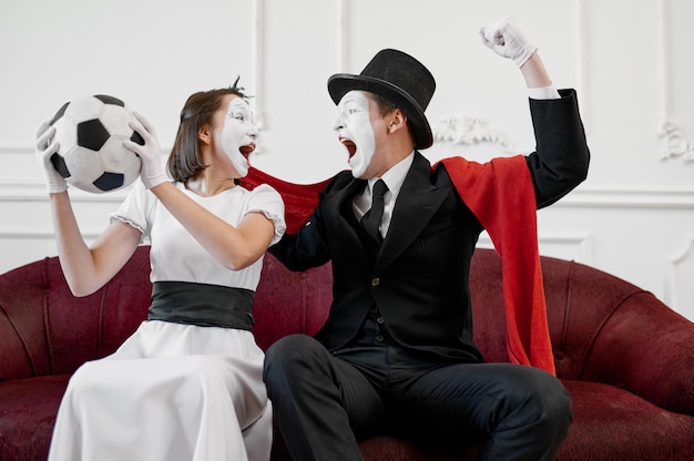Two mime artists, football fans parody