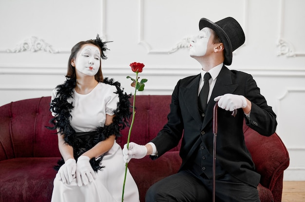 Two mime artists, love couple, scene with rose