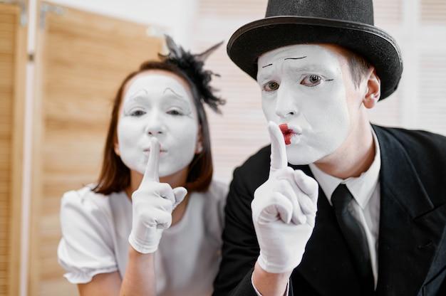 Two mime artists, secret gesture, parody