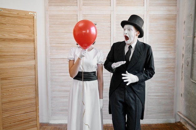 Two mime artists with air balloon, comedy parody