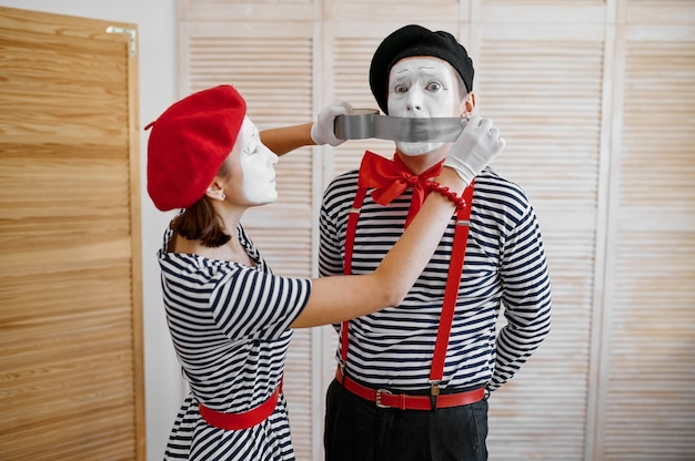 Two mime artists with duct tape, parody comedy