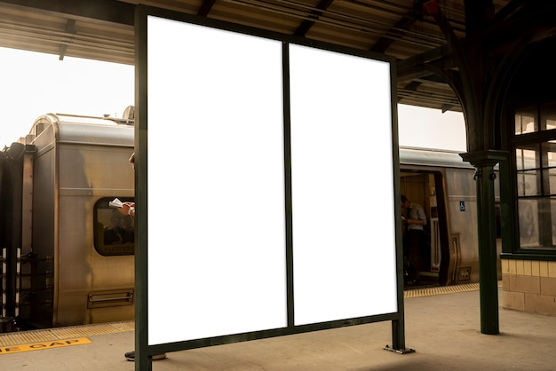 Two mock-up billboards in a train station